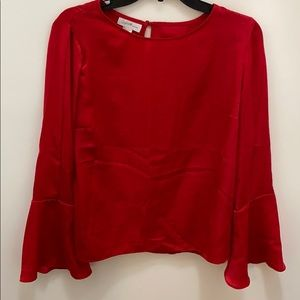 JESSICA SIMPSONS red blouse bell sleeves